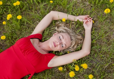 pretty young woman: pretty young woman sleeping on a meadow