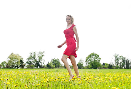 happy young woman on a meadow photo