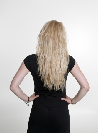woman in black dress, rear view photo
