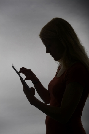 young blond woman with tablet pc photo