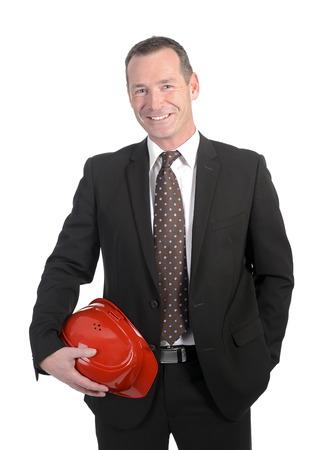 casco rojo: empresario de risa que sostiene el casco rojo Foto de archivo