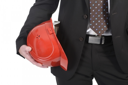 businessman holding red helmet, detail photo