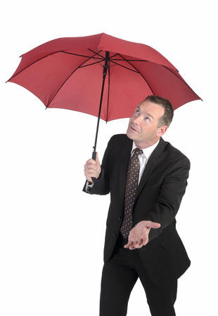 personable: friendly businessman with red umbrella  Stock Photo