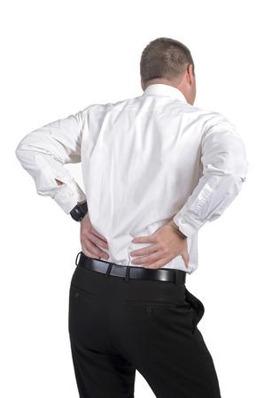 bracing: businessman has a lumbago, rear view
