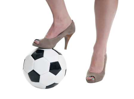 soccer ball and high heels, isolated on white background photo