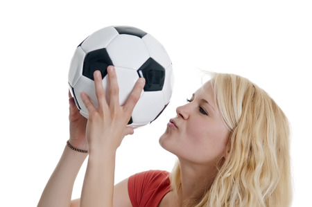 young blond woman kissing soccer ball photo