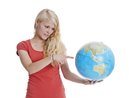 beautiful young blond woman showing globe photo