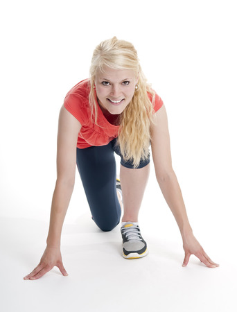 start position: young blond woman in start position
