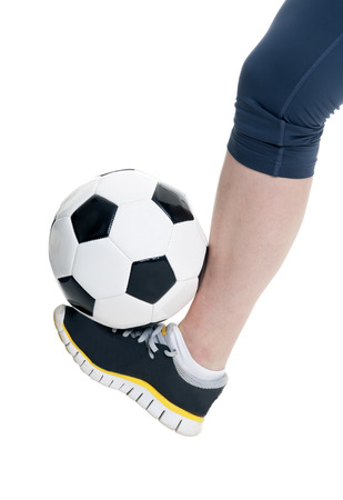 woman foot: woman foot with soccer ball, isolated on white background