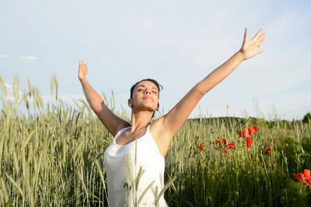 arms  outstretched: smiling young woman feeling free