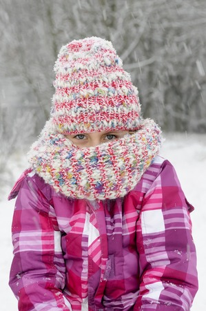 little girl with cap freezing Stock Photo