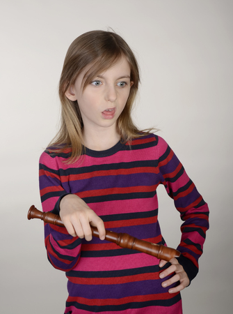 annoyed girl: annoyed little girl with recorder