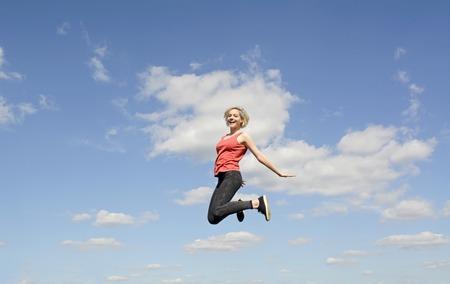 soulfulness: joyful young blond woman leaping