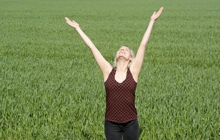 soulfulness: young blond beautiful woman cheering Stock Photo