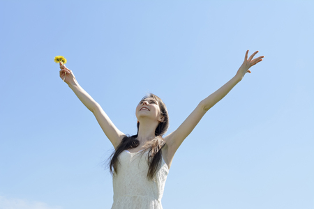 outstretched: young  beautiful woman cheering, arms outstretched Stock Photo