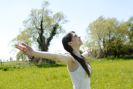 soulfulness: young  beautiful woman cheering, arms outstretched Stock Photo