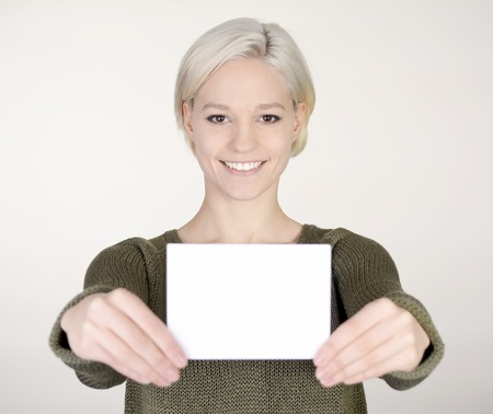 woman with white business card