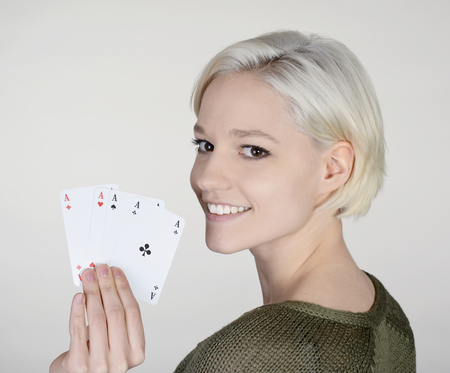 skat: happy young woman with four aces