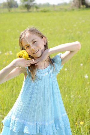 laughing  little girl with dandelions photo