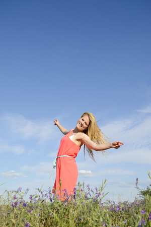 downtime:  happy young woman  on flower meadow