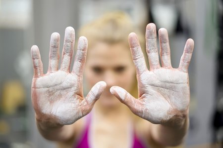 happy young blond woman , fitness center