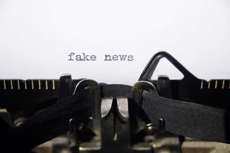 fake news on old typewriter Stock Photo - 80351185