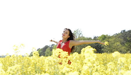 Young woman cheering in the rape field