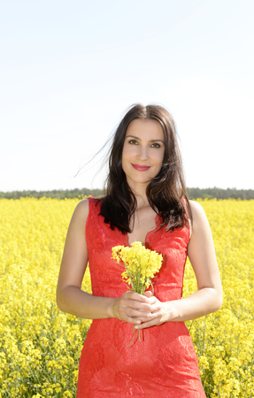 happy young woman  in the rape field Stock Photo