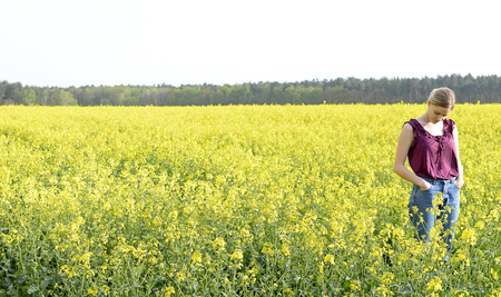 dreamy young woman  in the rape field
