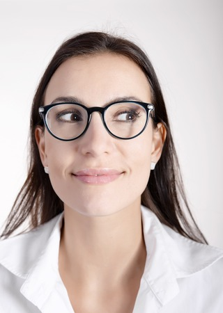 smiling young woman with dark hairs and glasses