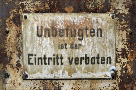 Old rusty warning sign entry forbidden Reklamní fotografie