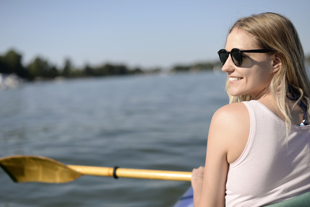 young blond woman in boat