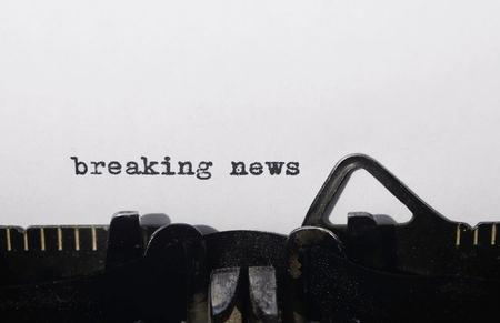 breaking news on old typewriter