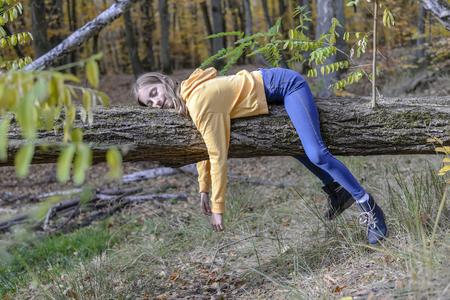 lazy teenager lying on tree Stockfoto