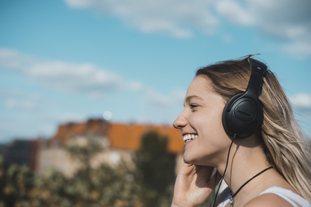 young blond woman with headphones Stock Photo