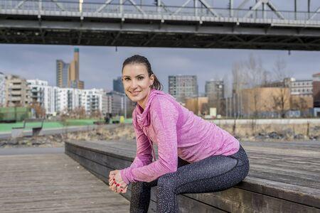 smiling young sportswoman Фото со стока