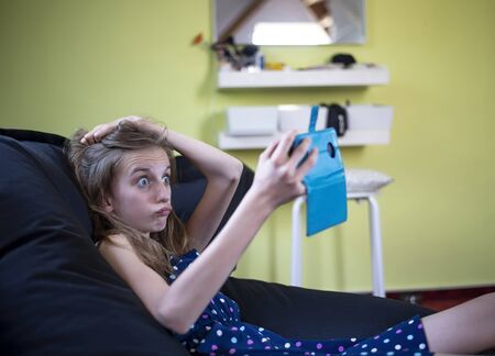 afraid young girl with smartphone