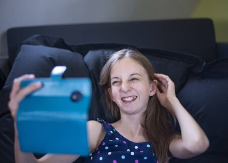 happy young girl with smartphone Stock Photo