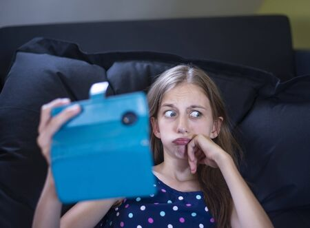 pensive young girl with smartphone