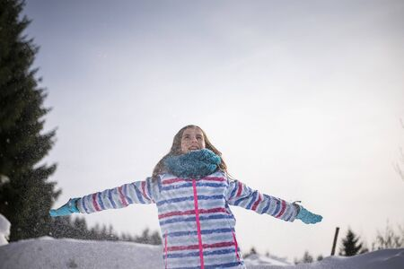happy young girl playing with snow   Reklamní fotografie