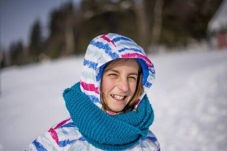 young girl having fun in winter