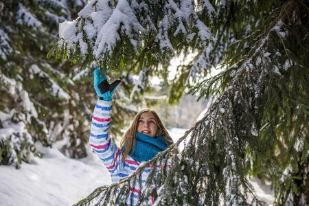 happy young girl playing with snow