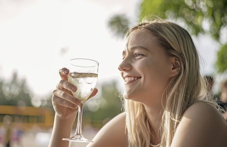 happy young woman drinking wine