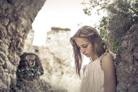 pensive young girl with long hairs