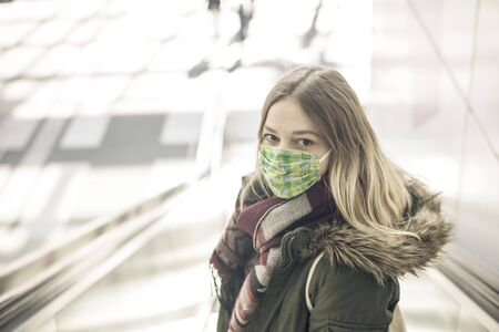 young woman with mask in the city