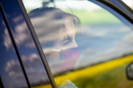 girl with mouthguard waiting in car