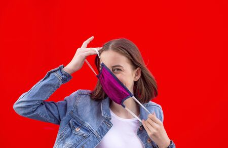 girl with mouthguard against red background