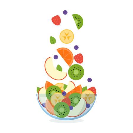Fruitsalade in een glaskom met ingrediënten die in de lucht vliegen die op witte achtergrond wordt geïsoleerd.