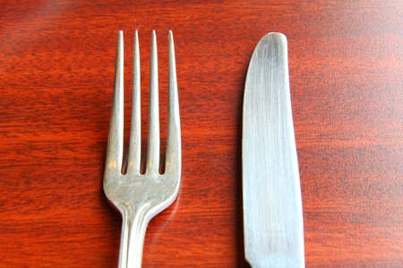 fork and spoon isolated on dining table photo