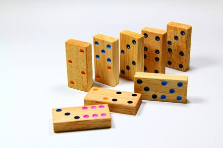 regimented: wooden dominos isolated on white background Stock Photo